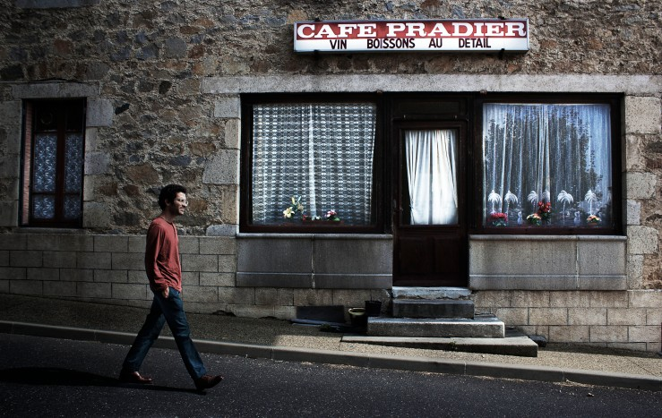 André walking by Café Pradier, Verne, Auvergne, France | Infinite belly